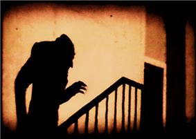 A famous scene from one of the first notable horror films, Nosferatu (1922)