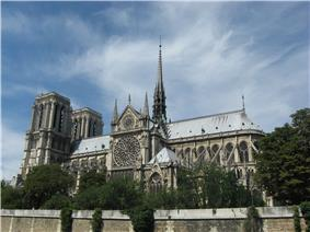 Notre Dame, Paris, is a grand Gothic cathedral with Towers at one end and a small spire rising from the centre of the roof.