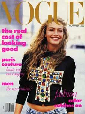 November 1988 cover of American Vogue magazine, showing model Michaela Bercu, shot from just below the waist in natural outdoor light, wearing a $10,000 jewel-encrusted Christian LaCroix T-shirt with faded 450 jeans. The top headline on the cover reads