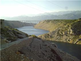Reinforced concrete arch bridge across Novsko Ždrilo strait near Maslenica.