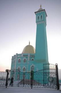 Teal mosque with small gold dome
