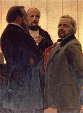 Three men standing together– two men with beards, the one on the right with grey hair, flanking a third man watching them intently