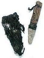 A knife made from stone, and a woven sheath