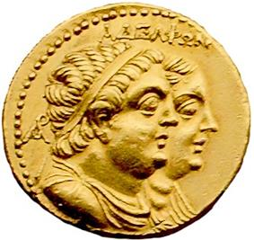 A gold coin shows paired, profiled busts of a plump man and woman. The man is in front and wears a diadem and drapery. It is inscribed
