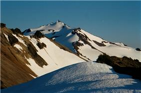 Partially snow-covered Old Snowy Mountain.