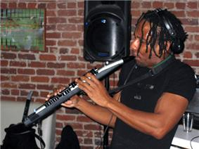 A performer playing a MIDI wind controller