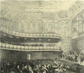 interior of nineteenth century concert hall, with audience in place