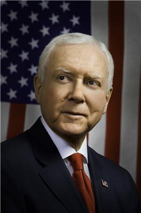 Upper-body portrait of a twenty-first-century man in a suit.