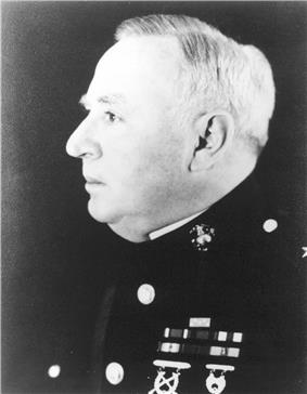 Side profile of head and chest of older, plump man in dress U.S. Marine uniform.