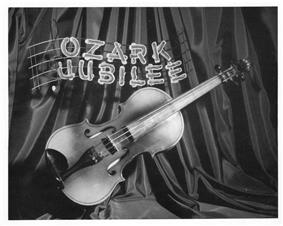 promotional photo showing a fiddle with the words Ozark Jubilee above it