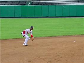 Baseball great is seen fielding a ground ball on a dirt infield