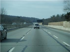 Straight, lightly-traveled section of six-lane highway
