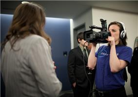 Planet Forward intern Sarah Snyder videos during the 2011 PBS special reception.