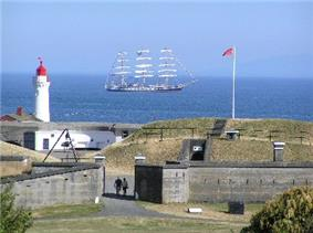 Lower battery of Fort Rodd Hill with a tall ship in the background