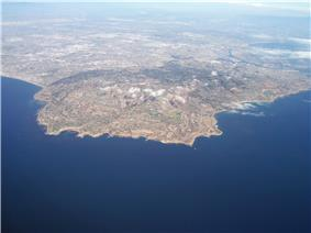 Aerial view of the Palos Verdes Peninsula and the Palos Verdes Hills, with Los Angeles in the distance