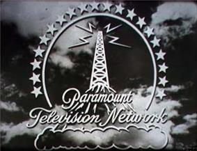 A stylized broadcasting tower atop a mountain high above the clouds, surrounded by a halo of 20 stars. Four lightning bolts emit from the top of the tower. The logo is superimposed over stormy clouds.