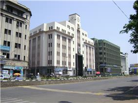 a multi storeyed building, with road in the foreground