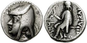 Two sides of a silver coin. The one on the left bears the imprint of a man's head, while the one on the right a sitting individual.