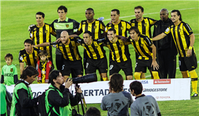 Players in uniform, posing for photographers