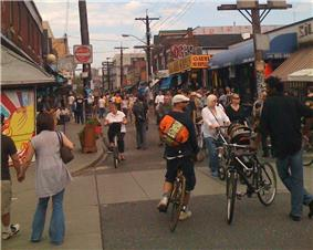 View of pedestrians and cyclists in Kensington Market