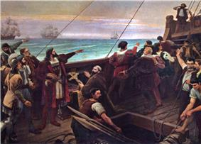 A painting depicting the deck of a wooden sailing ship on which stands a group of men pointing toward the horizon and with the sails of several other ships visible in the background