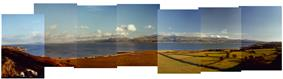 Panorama from Penmon old Deer Park across the Menai Strait  with Snowdonia in the background.