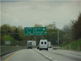 Cars and trucks on four-lane, divided highway