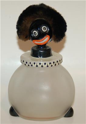 A 1920s golliwog perfume bottle