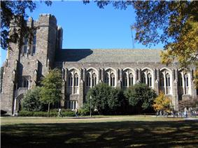 A building's Gothic-style exterior and grass lawn in foreground