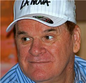 A middle-aged white male wearing a white cap.