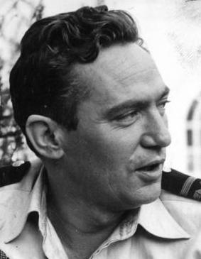 Black and white photo of Peter Finch during filming of the 1955 film, Passage Home.