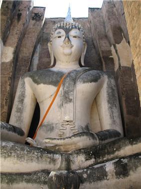 Large white seated Buddha statue.