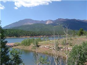A lake and mountains in Pike National Forest.