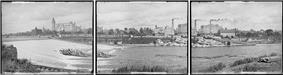 panorama seen from west side of river looking east, large sign or banner says