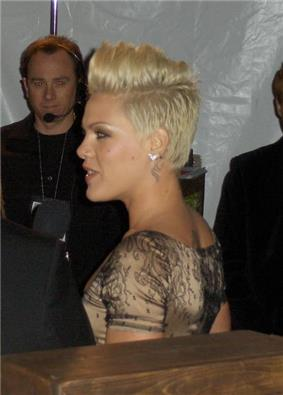 A woman with short blond hair