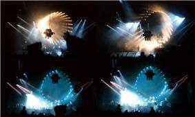 Four images, arranged to form a rectangle, of a darkened concert venue. The stage is dominated by a circular pattern of lights which surround a projection screen. Members of the audience are silhouetted in the foreground.