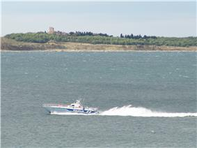 Small police boat on large body of water