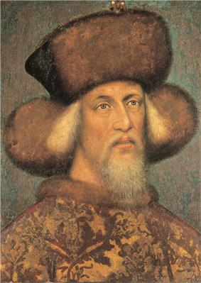 An elderly bearded man wearing a hat made of fur