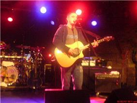 Image of Plan B playing guitar at a concert