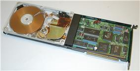 A Hardcard 20 hard disk on a card with a Plexiglass cover for display purposes. The Hardcard from Plus Development was the first hard drive on a plug in card for PCs.