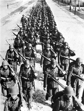 Photo of a column of troops marching