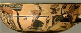 One side of a painted bowl. A mounted youth holding a spear rides away from a fountain. A woman runs after him. She is looking back towards the fountain.