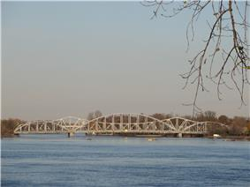 Two non-identical steel frame bridges side by side.