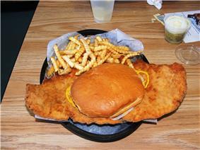 Pork tenderloin sandwich with French fries