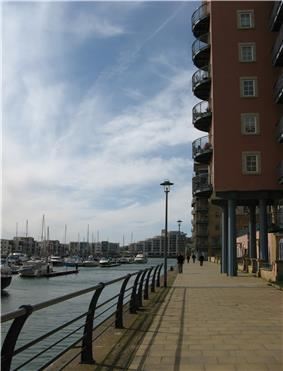 New apartments blocks with boats moored in the marina.
