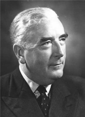 Menzies was thickset elderly Anglo-Saxon man, cleanshaven and wearing a suit.