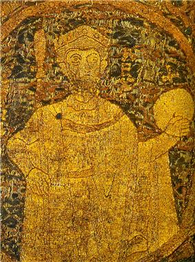 A gilded cloat depicting a bearded man with large eyes wearing royal insignia