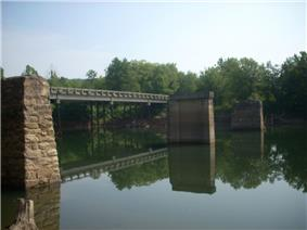 Bridge piers in the foreground are from the covered bridge that burned