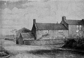 Black-and-white drawing of a two-story brick house along a road.
