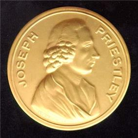 Photograph of a gold medal, which says